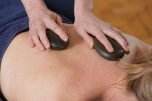 Hot Stones Massage Therapy - Treatments and Services - Courtyard Clinic Malmesbury
