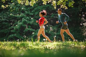 Runners in woodlands
